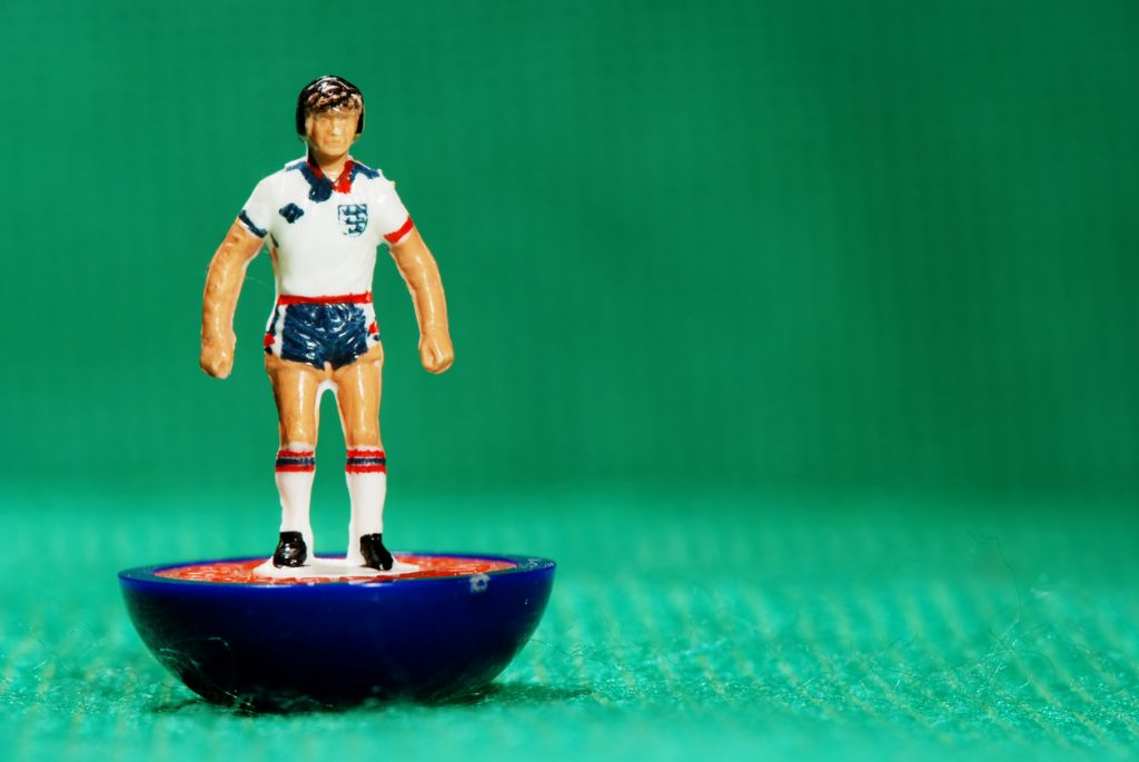 Pila, Italy - May 26, 2011: Vintage Subbuteo miniature toy of a soccer player of the English national team. Subbuteo is a set of table top games simulating team sports such as soccer, cricket, rugby and hockey created by Peter Adolph.